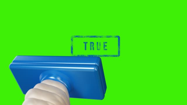 hand stamping True on green screen