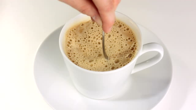 HD SLOW MOTION: Hand Stirring Cappuccino video