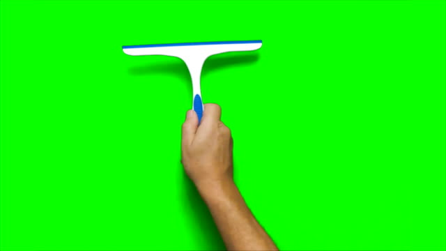 hand swiping squeegee vertically down screew - addetto alle pulizie video stock e b–roll