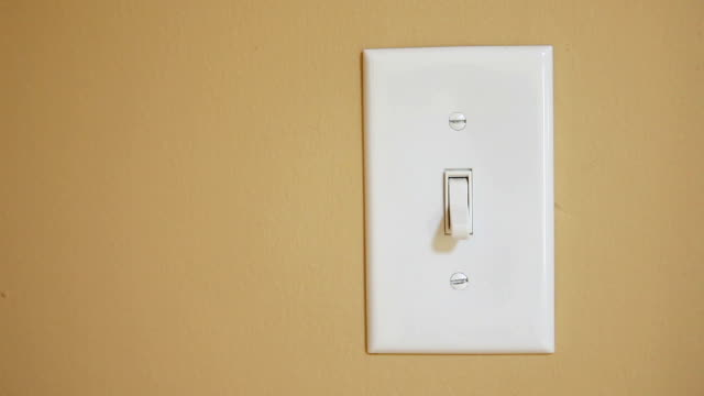 Hand Switching Light Switch Off and On video