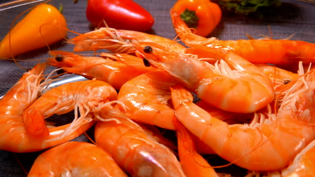 Hand takes bright juicy shrimp from a bowl Female hand takes bright juicy shrimp from a transparent bowl shrimp seafood stock videos & royalty-free footage