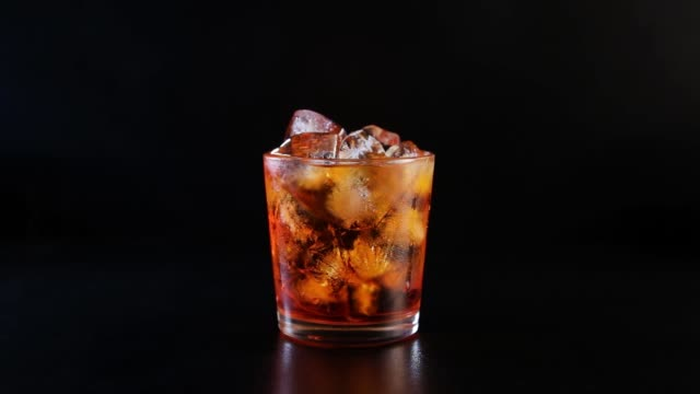 A hand taking away glass with alcohol video