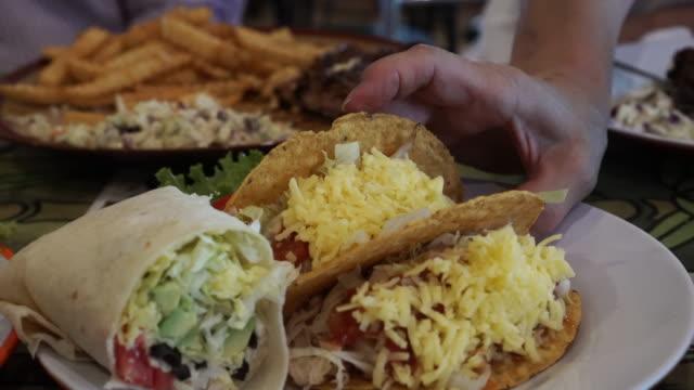hand taking big corn tortilla taco cheese - węglowodan jedzenie filmów i materiałów b-roll