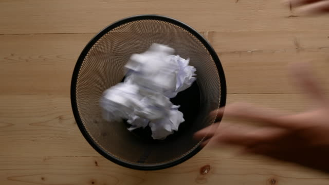Hand throw crumpled into the trash. video