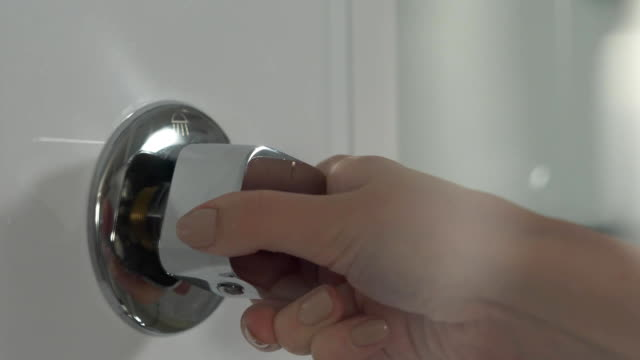 Hand turn on faucet shower cabin. Opening a water tap. Open valve shower video