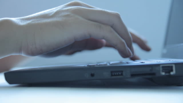 HD : Hand typing a laptop video