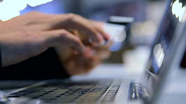 Hand typing on laptop while holding credit typing on laptop while holding credit gold card stock videos & royalty-free footage