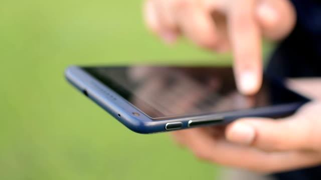 Hand using smartphone video