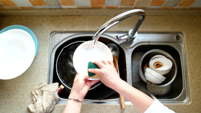 Hand washing dishes Hand washing dishes kitchen sink stock videos & royalty-free footage