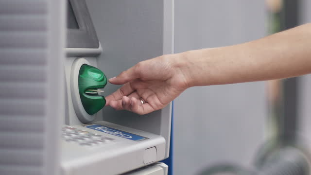 Hand with credit card, using a ATM Hand with credit card, using a ATM in slow motion banks and atms stock videos & royalty-free footage