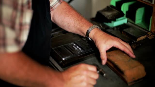 Hand with letterpress blocks video