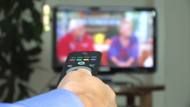 Hand With TV Remote Control video