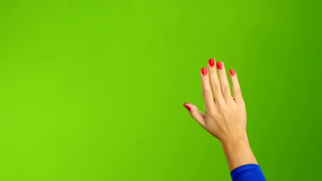 Hand woman waving hello or goodbye on green screen background video