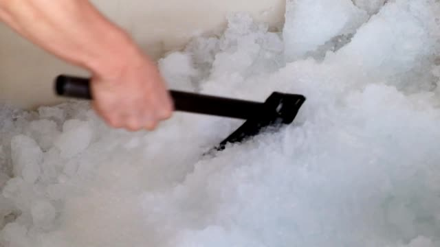 Hand worker using axe chopped ice flake video