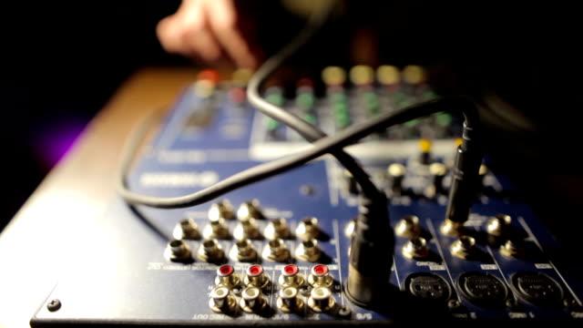 Hand working on msound mixer video