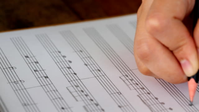 Hand writing musical notes (Dolly shot) video