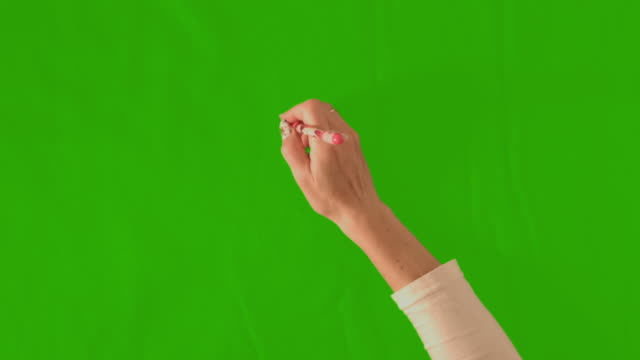 Hand writing on a green background video