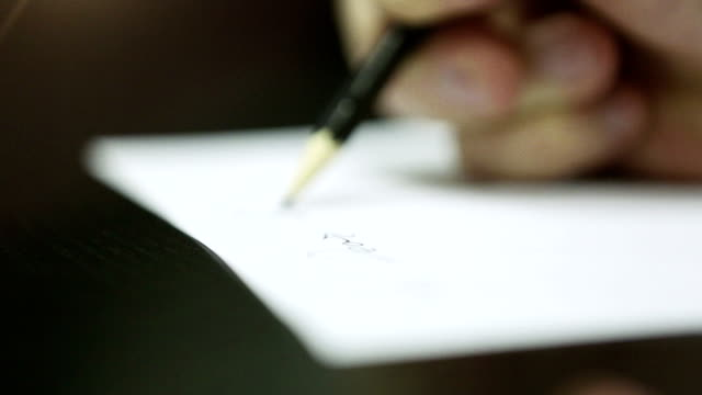 Hand Writing on a Piece of Paper. DOF. HD 1080. video