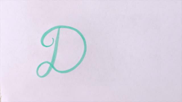vídeos de stock, filmes e b-roll de escreva a palavra pai em cursiva com uma caneta verde escova - dia dos pais