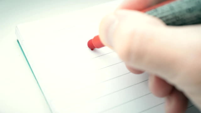 hand writing the word goal with red marker in notepad - goals filmów i materiałów b-roll