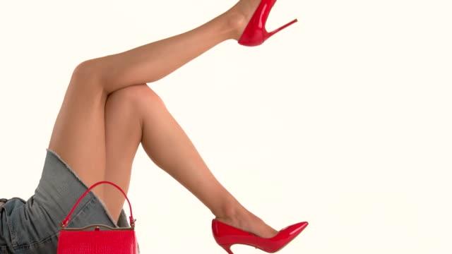 Handbag and woman's legs. video
