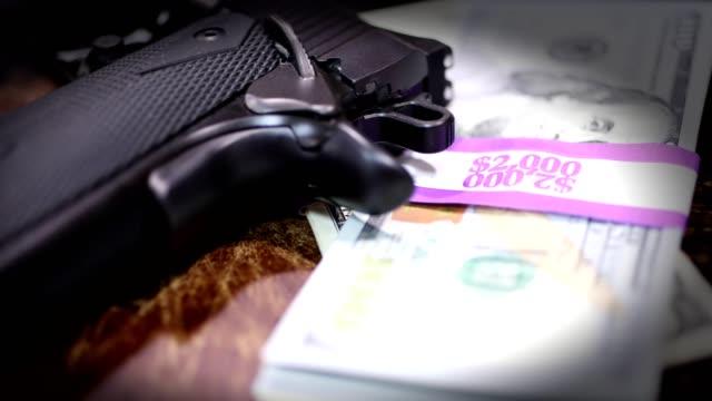9MM handgun and stacks of $100 bills in $2000 wrappers. video