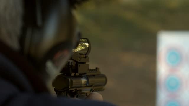 Handgun with Sight at Shooting Range with Target
