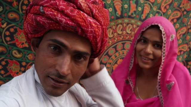 handheld pov of a camera taking selfie photos of a beautiful indian couple in traditional clothing in rajasthan, india - kultura indyjska filmów i materiałów b-roll