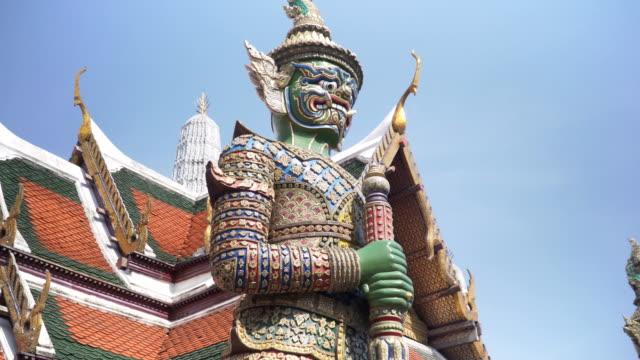 handheld low angle view: Demon Guardian at Grand Palace Thailand, Bangkok