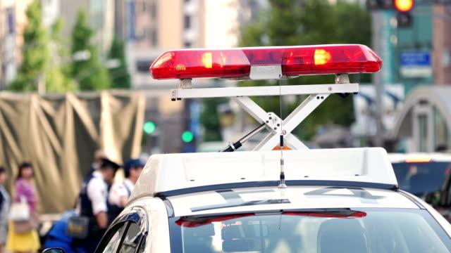 4K Handheld Police lights flashing at downtown, Japan.