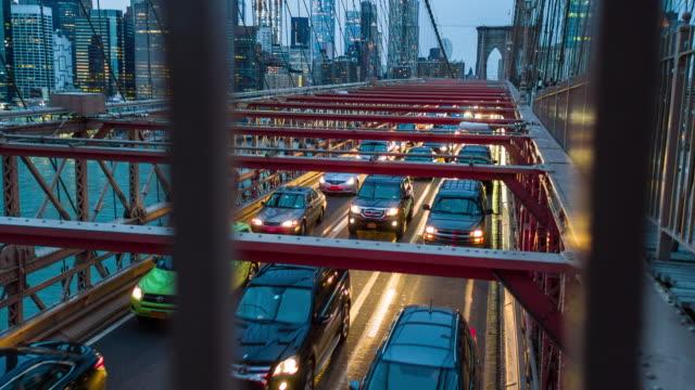 Handheld real time video of traffic in Brooklyn Bridge at dusk video