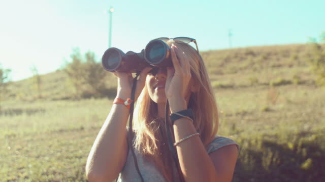 Handheld shot of girl looking with binoculars video