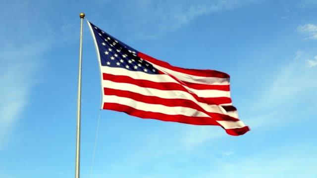 handheld shot of vibrant american flag waving in the wind. - bandiera degli stati uniti video stock e b–roll