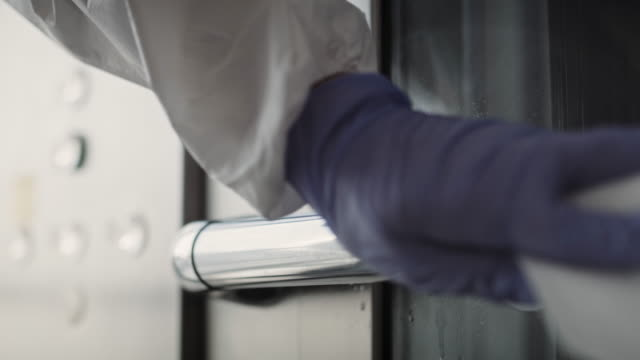 handheld video of hands disinfecting a handrail. shot with red helium camera in 8k. - parapetto barriera video stock e b–roll