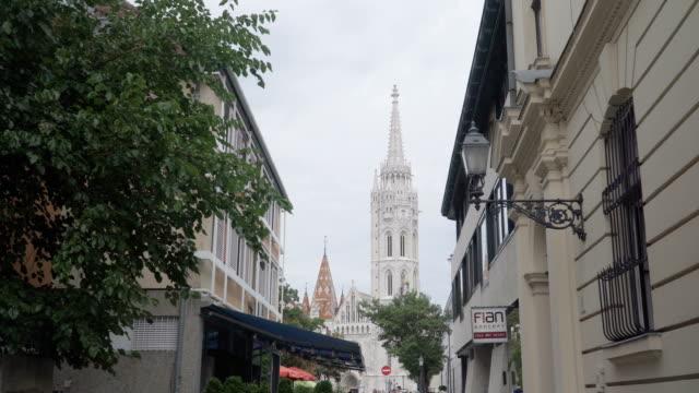 handheld view: walking along street to Matthias Church in Fisherman Bastion, Budapest, Hungary