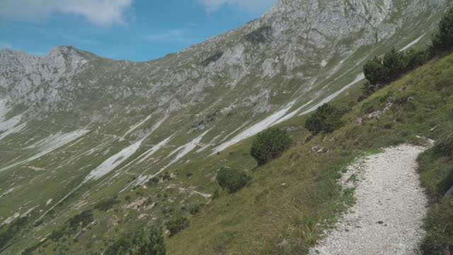 handheld view: walking on trail on slope of alps of Austria in summer, Hafelekarspitze-Seegrube at Karwendel Mountain,Innsbruck Austria