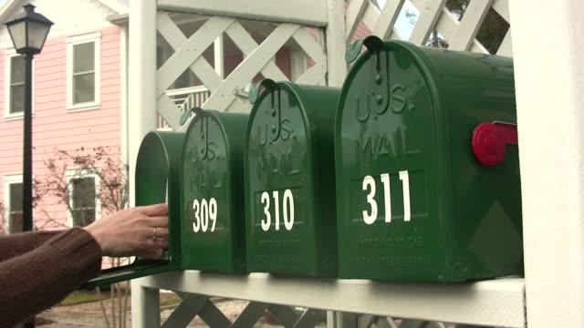 Handing reaching into a mailbox video