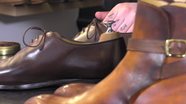 handmade coloring and care of footwear waxing and water pose to glaze the surface of leather dress shoe stock videos & royalty-free footage