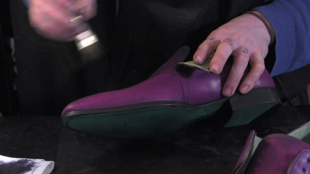 handmade coloring and care of footwear creating a patina with a brush dress shoe stock videos & royalty-free footage