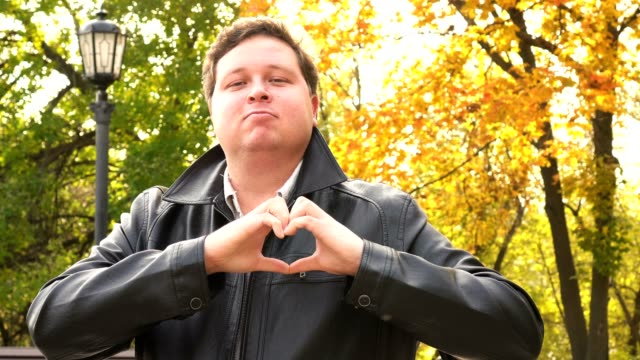 Handmade Heart Sign by Young Man, outdoor video
