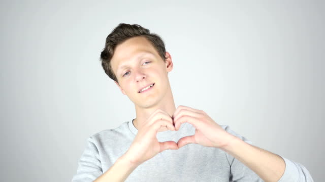 Handmade Heart Sign, Young Man Expressing Love, Isolated Gesture