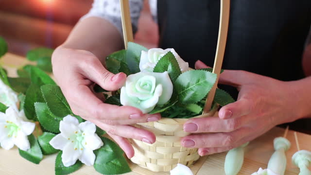 Handmade soap in the shape of a flower in a woman's hand
