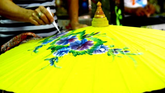 Handmade Thai style umbrella painting Handmade Thai style umbrella painting, Chiang Mai, Thailand painting art product stock videos & royalty-free footage