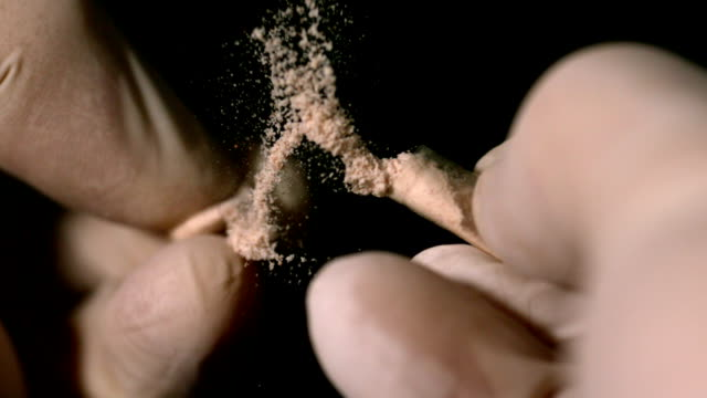 Hands breaking a pill capsule in half video