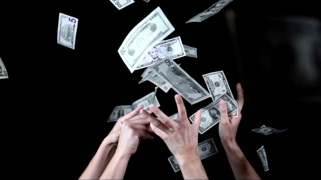 Hands Catching Falling Dollars (Super Slow Motion) HD1080p: Super Slow Motion shot of hands catching dollar bills. Recorded at 2000 fps catching stock videos & royalty-free footage