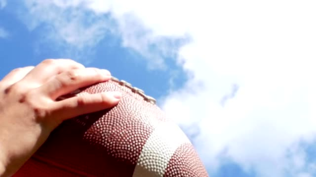 hands catching rugby, football ball, slow motion - praticare video stock e b–roll