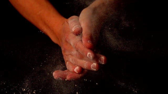 Hands clapping and dusting flour off Hands clapping and dusting flour off in slow motion flour stock videos & royalty-free footage