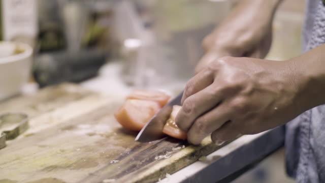 CU : Hands Cutting Tomato video