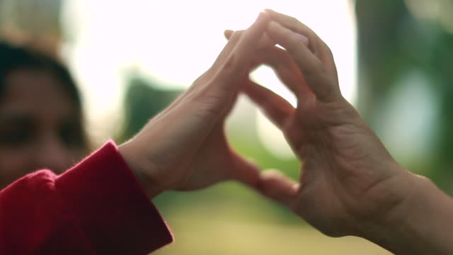 Hands doing heart shape symbol and holding hands together Hands doing heart shape symbol and holding hands together gesturing stock videos & royalty-free footage