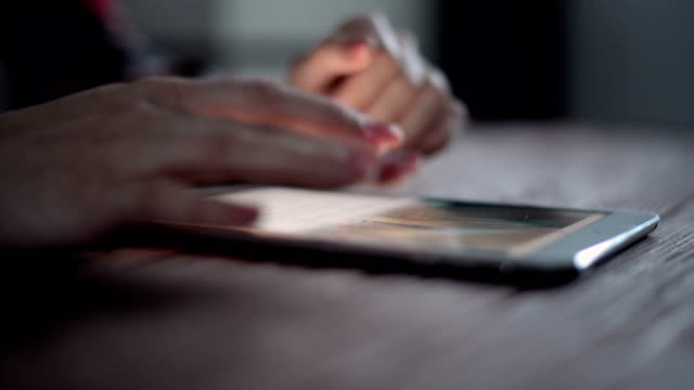 Hands doing multi-tasks on the electronic digital tablet video